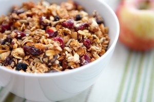 A healthy breakfast of granola with an apple.