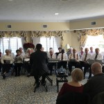 Legacy at Clover Blossom's Choir performing in the Piano Room.