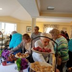 Residents enjoying the excellent finger foods at the Tea Party.