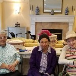 Residents being social at the Tea Party.