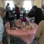 Residents helping themselves to tea.
