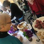 Residents selecting finger foods.