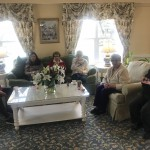 Residents enjoying each others company, along with the tea, in the comfort of the living room.