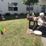 Resident taking her try at the ring toss