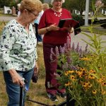 Residents at Butterfly Garden look at new plants
